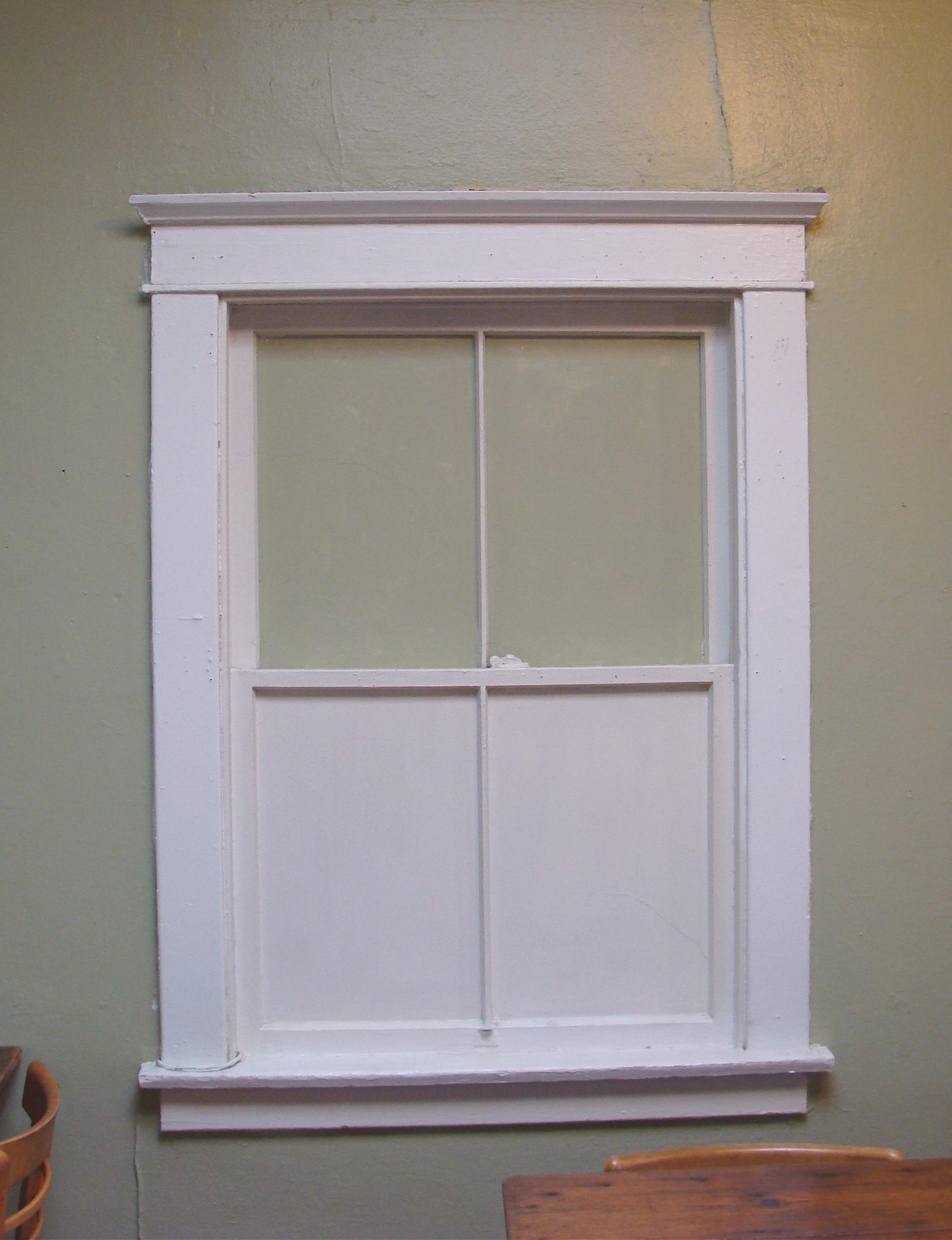 Craftsman style window surround, header or entablature inside a ...